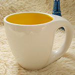 inside yellow ceramic mugs